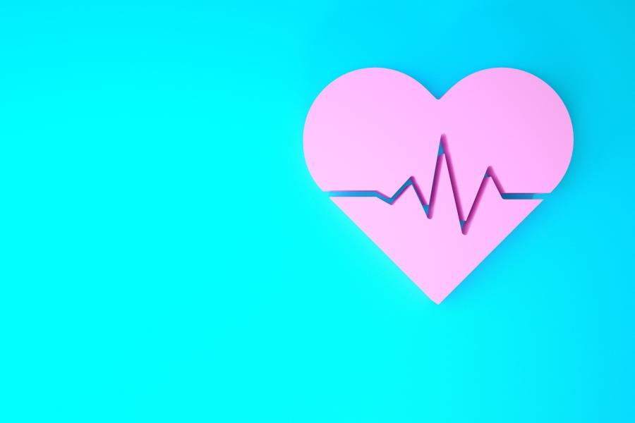 Grafika przedstawia różowe serce na turkusowym tle, na nim linię ilustrującą prawidłowy puls